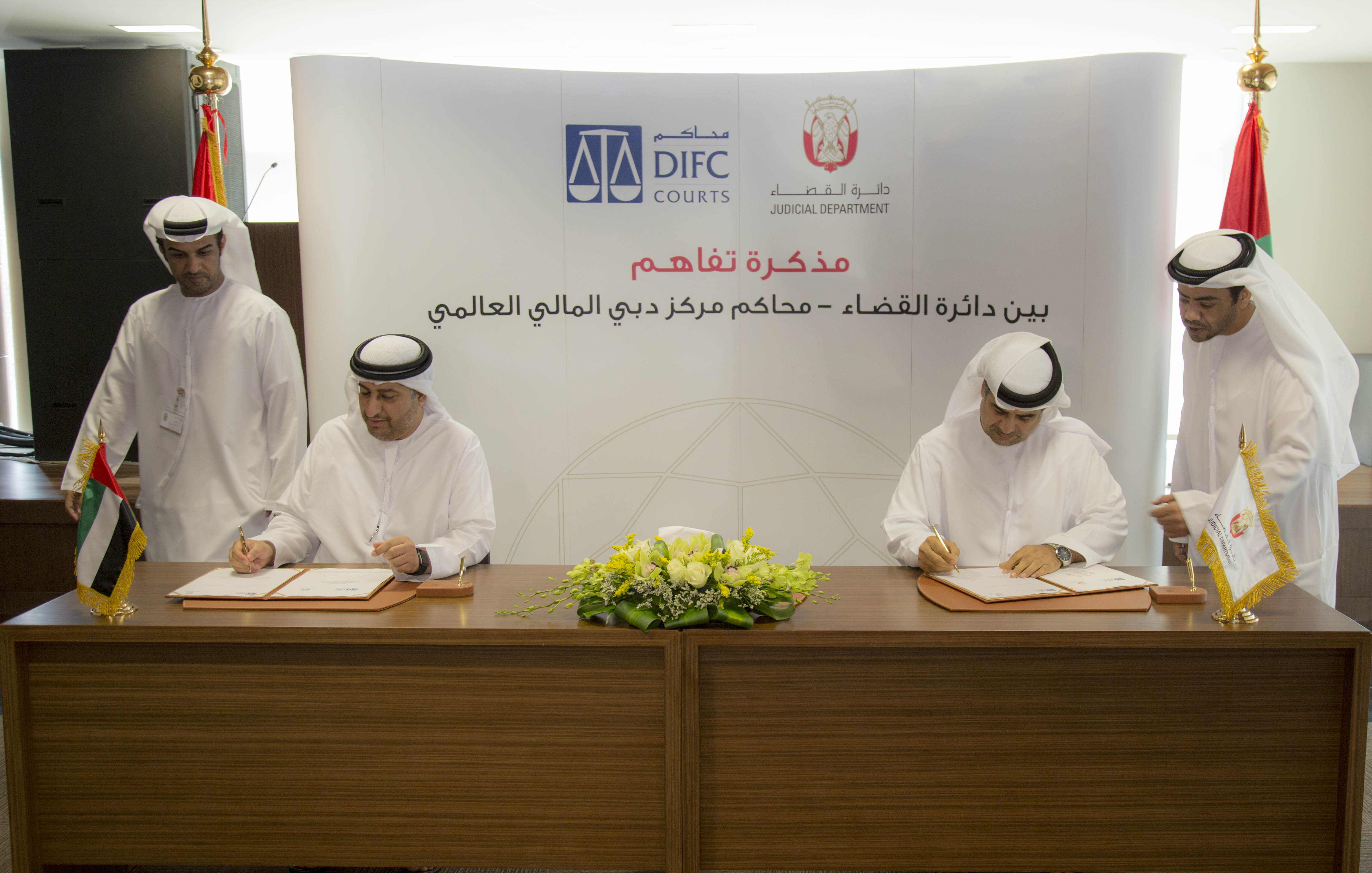 (L-R) HE Omar Juma Al Muhairi, Senior Judge, DIFC Courts and HE Chancellor Yousuf Alabri, Abu Dhabi Judicial Department Undersecretary sign the MoU agreement